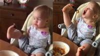 感动!无手女童努力用脚吃饭