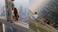 """女模爬300米高楼拍""""亡命照"""""""