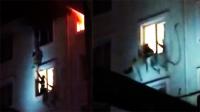 女子跳楼逃生消防员一把抓住