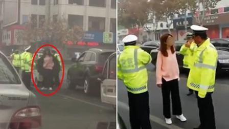 奥迪女司机脱大衣猛打交警 其丈夫曾是公安局副局长的司机