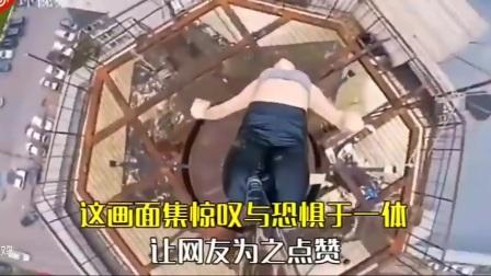 有人在高楼,天线杆上,跳钢管舞!