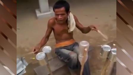老挝牛人把破旧塑料瓶牛奶罐当架子鼓,即使眼