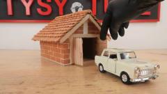 外国牛人用砖块自制家庭车库,外型很逼真,效