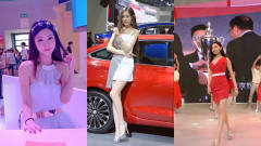 美女车模:红色跑车配上白衣车模,这是什么神