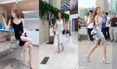 美女街拍:气质美女穿短裙逛街,大长腿一览无