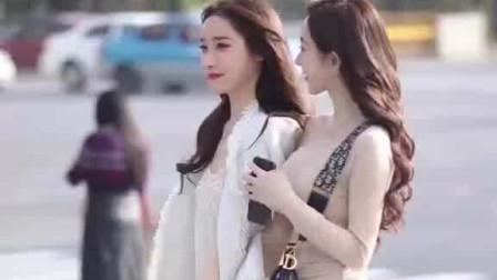街拍:听说20岁以下喜欢短裙,20岁以上喜欢长裙