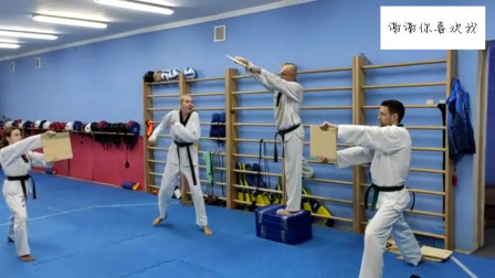 俄罗斯跆拳道学员踢板都是实木的!