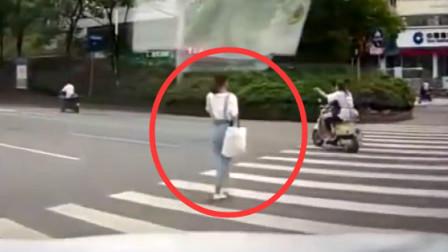 美女过马路,头也不回,老司机也无济于事