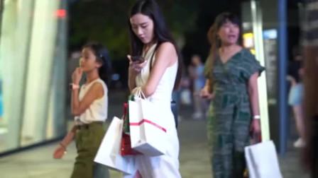 北京街拍,老公年薪百万的老婆与年薪十万的老