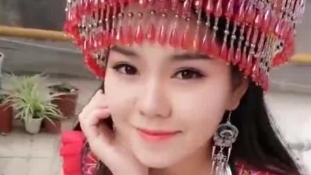 这个苗族美女好漂亮,笑容甜美的美女,精致的
