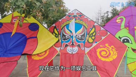 西永广场好热闹,周末大人陪着小孩放风筝