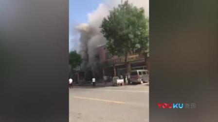 连救三场大火消防员几近昏厥   市民纷纷上前扇扇子递水