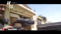 摄像机挡住子弹 伊拉克记者逃过一劫